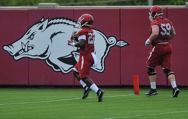 Rawleigh Williams and Marcus Danenhauer  during the first  Fall Razorback Football practice on Thursday, August 6, 2015 at the Fred W. Smith Football Center in Fayetteville, Arkansas.   Photos by Alan Jamison.