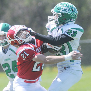Parker Moore of Red Jacket ties up Garrett Totten of Pembroke despite getting stiff armed. Photo by Jack Haley for Daily Messenger.