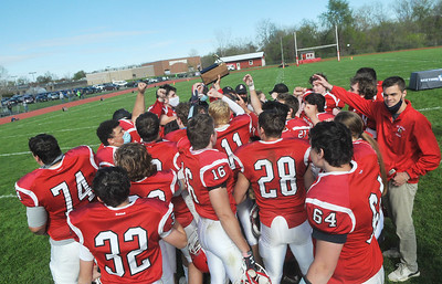 The Red Jacket Indians celebrate their 8-Man sectional championships after knocking off Pembroke 82-6 on Saturday. Photo by Jack Haley for Daily Messenger.