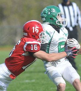 Mason Pollot of Red Jacket tackles Tyson Totten of Pembroke during the Indians lopsided win. Photo by Jack Haley for Daily Messenger.