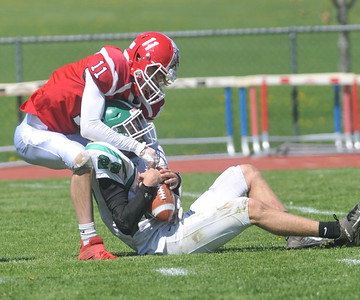 Garrett Totten of Pembroke hangs on to a catch while Red Jacket's Daltyn Hanline makes the tackle Photo by Jack Haley for Daily Messenger.