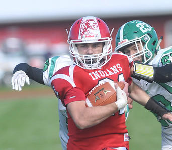 Pembroke's Tyson Totten and Garrett Totten (23) stop Red Jacket running back Parker Moore two yards shy of a possible 88 yard touchdown run in the second half. Photo by Jack Haley for Daily Messenger.