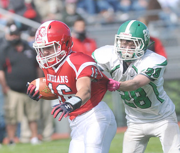 Brady Kimmel of Pembroke tries to hang on to Red Jacket running back Mason Pollot. Photo by Jack Haley for Daily Messenger.