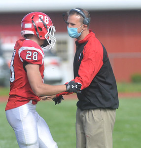 Red Jacket head coach Joshua Henninger talks with senior running back Logan Keifer after Keifer was taken out of the game during the Indians win over Pembroke. Photo by Jack Haley for Daily Messenger.