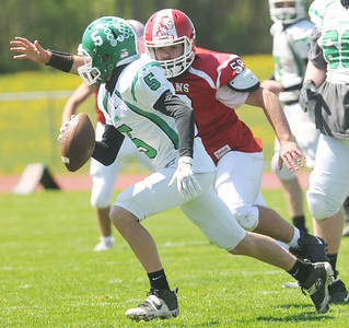 Red Jacket's Kyle Footer is closing in on Pembroke's Tyson Totten. Photo by Jack Haley for Daily Messenger.