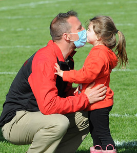 Red Jacket head coach Joshua Henninger gets a special present after his Indians won the 8-man Section V championships with a dominant 82-6 win over Pembvroke on Saturday. Photo by Jack Haley for Daily Messenger.