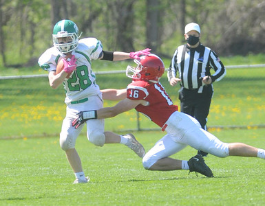 Brady Kimmel of Pembroke gives a stiff arm to Mason Pollot of Red Jacket on Saturday. Photo by Jack Haley for Daily Messenger.