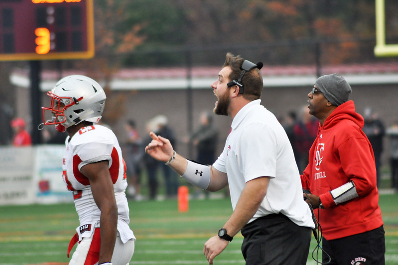 Coach Mike Ward instructing his defensive players for St. John's.