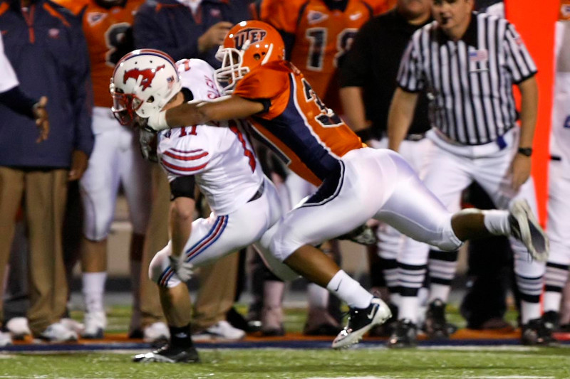 Senior Austin Contreras makes an open field tackle