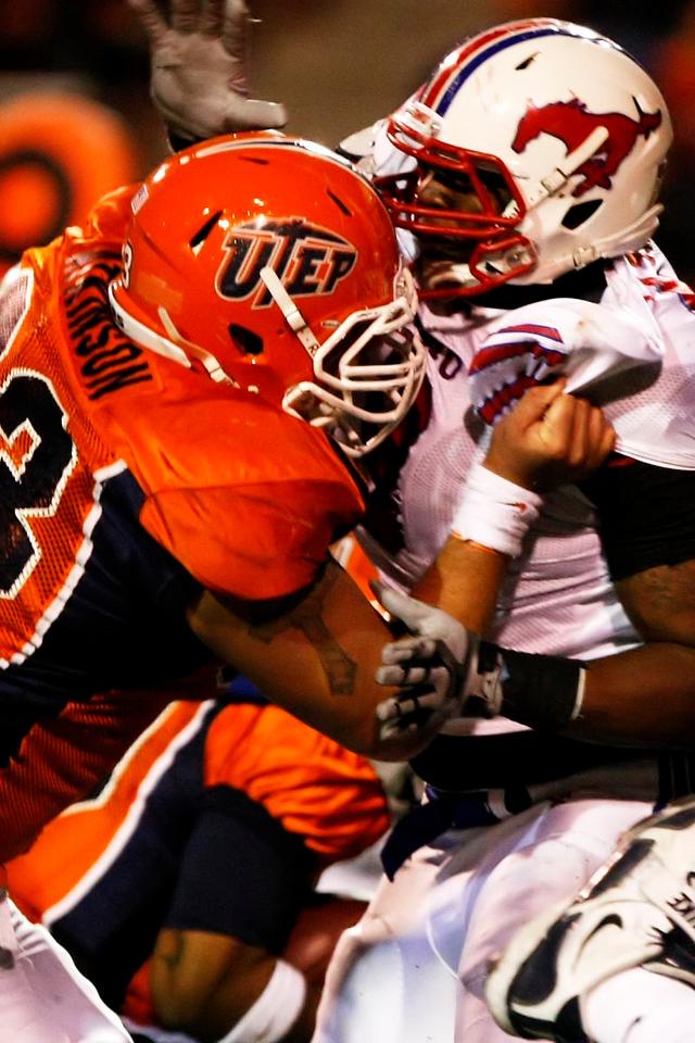 UTEP offensive lineman Eloy Atkinson manhandles an SMU defender