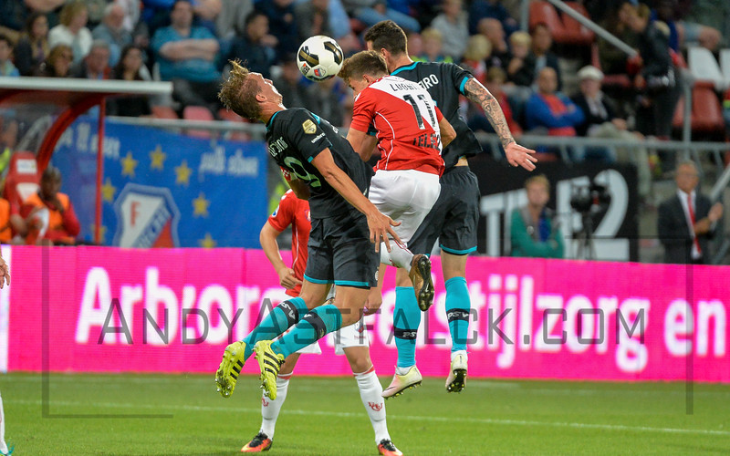 Andreas Ludwig from Utrecht is challenged by PSV players Luuk de Jong Gaston Pereiro during the Dutch Eredivisie Football match between FC Utrecht and PSV Eindhoven at Stadion Galgenwaard in Utrecht on August 6, 2016.