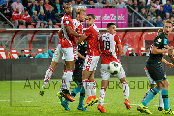 Utrecht defenders fail to block PSV's Gaston Pereiro's free kick that puts PSV into the lead (2-1) during the Dutch Eredivisie Football match between FC Utrecht and PSV Eindhoven at Stadion Galgenwaard in Utrecht on August 6, 2016.