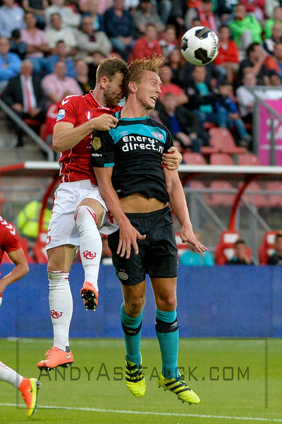 Luuk de Jong from PSV wins the ball in a challenge with Kevin Conboy from Utrecht during the Dutch Eredivisie Football match between FC Utrecht and PSV Eindhoven at Stadion Galgenwaard in Utrecht on August 6, 2016.