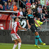 PSV's captain Luuk de Jong leaps to head the ball during the Dutch Eredivisie Football match between FC Utrecht and PSV Eindhoven at Stadion Galgenwaard in Utrecht on August 6, 2016.