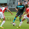Jetro Willems from PSV challenges Utrecht defenders Ramon Leeuwin and Giovanni Troupee during the Dutch Eredivisie Football match between FC Utrecht and PSV Eindhoven at Stadion Galgenwaard in Utrecht on August 6, 2016.
