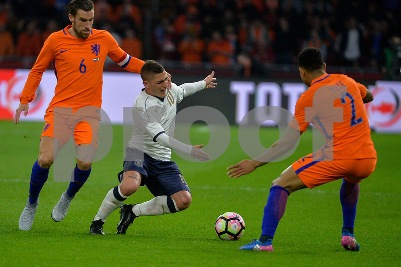 Netherlands  v Italy - International Friendly Marco Verratti from Italy is challenged by (L) Kevin Strootman and ® Kenny Tete from the Netherlands during the friendly match between Netherlands and Italy on March 28, 2017 at the Amsterdam ArenA in Amsterdam, Netherlands.