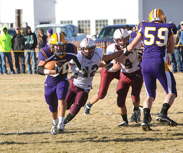Sioux County's Jonny Dunn breaks to the outside and then scampers for the 55-yard touchdown run in the third quarter of their playoff game against Silver Lake in Harrison on Friday. The Sioux County Warriors would win the game 48-35 and will play in the finals of the Nebraska six-man championship.