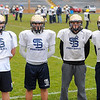 St. Bernard's seniors, from left, Brendan Kelley (offensive tackle, defensive tackle), Michael Alario (middle linebacker, right guard), Dominic Novelli (linebacker and tight-end), and Sean Maki (quarterback), pose for a photo during practice on Friday, before Saturday's Thanksgiving Day game against Boston Cathedral High School.<br /> SENTINEL & ENTERPRISE / BRETT CRAWFORD