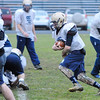 St. Bernard's Adam Hyde runs with the ball during practice on Friday, before Saturday's Thanksgiving Day game against Boston Cathedral High School.<br /> SENTINEL & ENTERPRISE / BRETT CRAWFORD