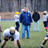 St. Bernard's Head Coach Tom Bingham looks on as his team runs a play during practice on Friday, before Saturday's Thanksgiving Day game against Boston Cathedral High School.<br /> SENTINEL & ENTERPRISE / BRETT CRAWFORD