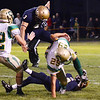 St. Bernard's #3 James Xarras charges after the Clinton offense during the season opener on Friday evening at the Bernardian Bowl. SENTINEL & ENTERPRISE / Ashley Green