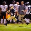 St. Bernard's quarterback Cooper Bigelow runs the ball during the 42-25 victory over Blackstone Valley Tech on Friday at the Bernardian Bowl. SENTINEL & ENTERPRISE / Ashley Green