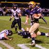 St. Bernard's Aaron Robichaud runs the ball during the 42-25 victory over Blackstone Valley Tech on Friday at the Bernardian Bowl. SENTINEL & ENTERPRISE / Ashley Green