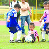 Kids from Don Bosco and Giuseppe fight for the ball in the P6 division in the 2nd Sun.Star Football Cup. (Allan Defensor)