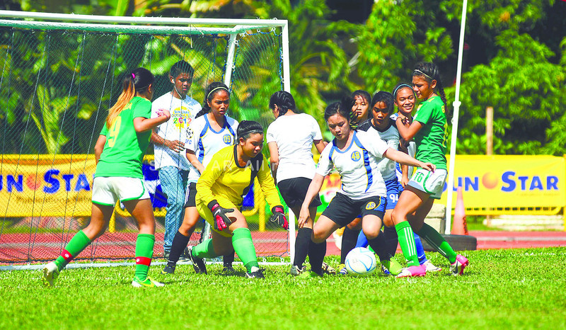 YOUNG PLAYERS. Eventual champions USC-A outclass reunited FC, 4-0, in the girls 19 group of the Sun.Star Cup Football tournament, held on the newly improved pitch of the Cebu City Sports Center. (Arni Aclao)