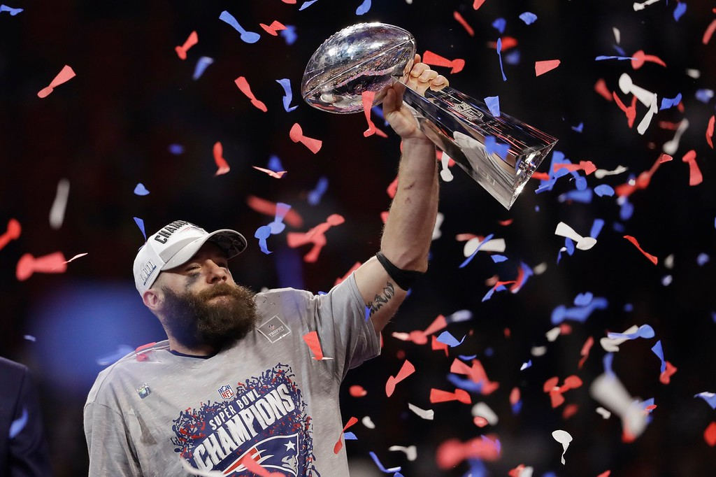 . New England Patriots\' Julian Edelman holds the Vince Lombardi Trophy, after the NFL Super Bowl 53 football game against the Los Angeles Rams, Sunday, Feb. 3, 2019, in Atlanta. The Patriots won 13-3. Edelman was named the Most Valuable Player. (AP Photo/Jeff Roberson)