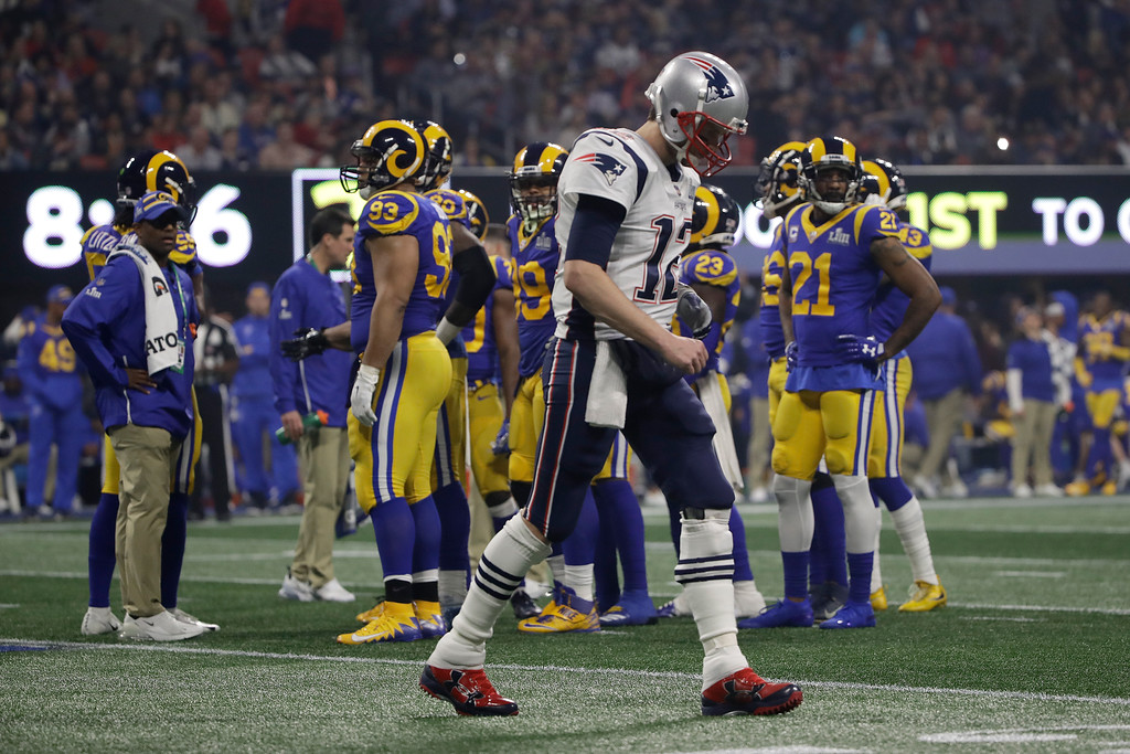 . New England Patriots\' Tom Brady (12) walks off the field during the second half of the NFL Super Bowl 53 football game against the Los Angeles Rams Sunday, Feb. 3, 2019, in Atlanta. (AP Photo/Matt Rourke)