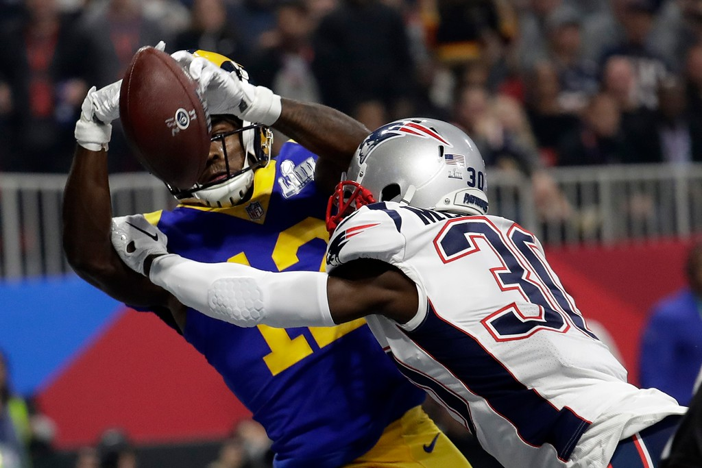 . New England Patriots\' Jason McCourty (30) breaks up a pass in the end zone intended for Los Angeles Rams\' Brandin Cooks (12) during the second half of the NFL Super Bowl 53 football game Sunday, Feb. 3, 2019, in Atlanta. (AP Photo/Lynne Sladky)