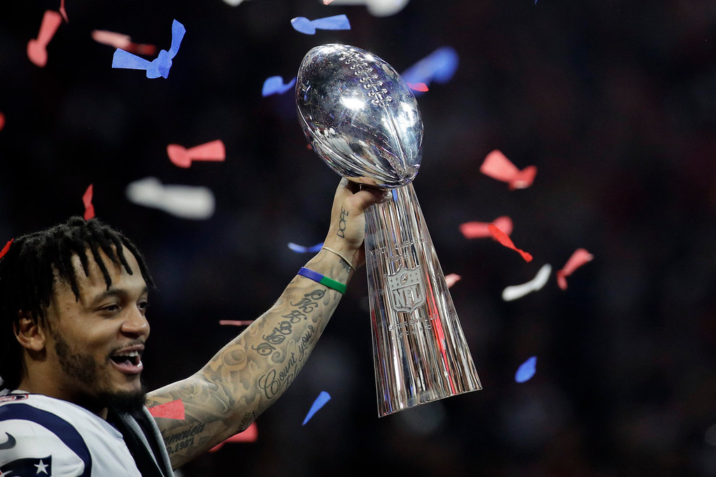 . New England Patriots\' Patrick Chung lifts the trophy after the NFL Super Bowl 53 football game against the Los Angeles Rams, Sunday, Feb. 3, 2019, in Atlanta. The Patriots won 13-3. (AP Photo/Patrick Semansky)
