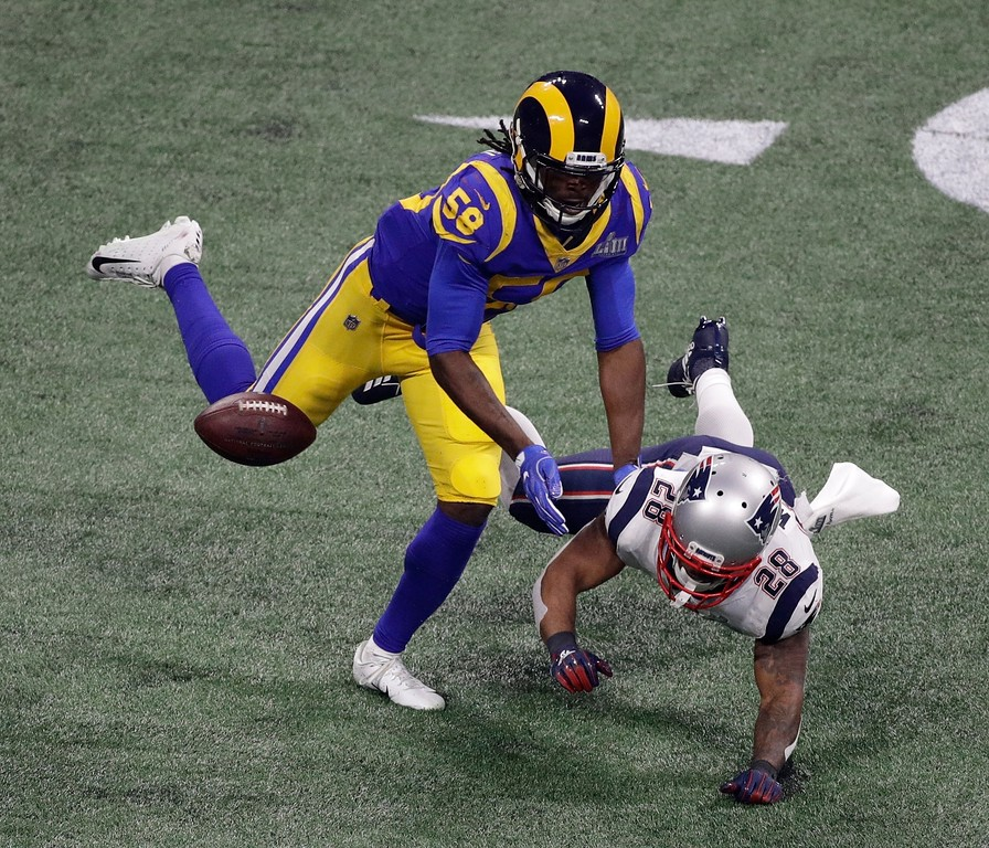 . Los Angeles Rams\' Cory Littleton (58) defends against New England Patriots\' James White (28) during the second half of the NFL Super Bowl 53 football game Sunday, Feb. 3, 2019, in Atlanta. (AP Photo/Charlie Riedel)