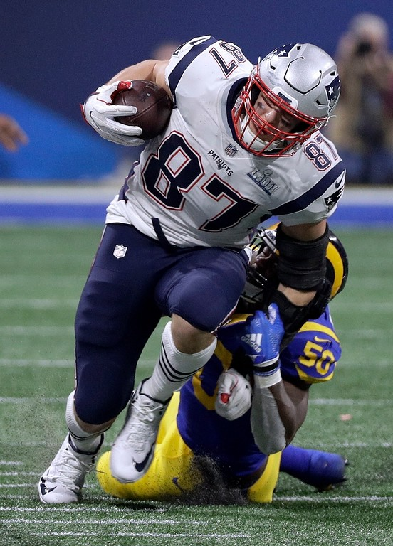 . New England Patriots\' Rob Gronkowski (87) is tackled by Los Angeles Rams\' Samson Ebukam (50) after catching a pass during the second half of the NFL Super Bowl 53 football game Sunday, Feb. 3, 2019, in Atlanta. (AP Photo/David J. Phillip)