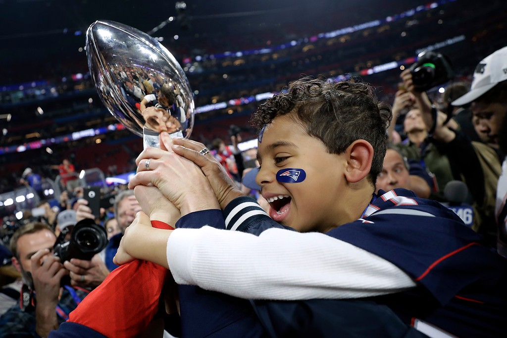 . A New England Patriots family member celebrates after the NFL Super Bowl 53 football game against the Los Angeles Rams, Sunday, Feb. 3, 2019, in Atlanta. The Patriots won 13-3. (AP Photo/David J. Phillip)