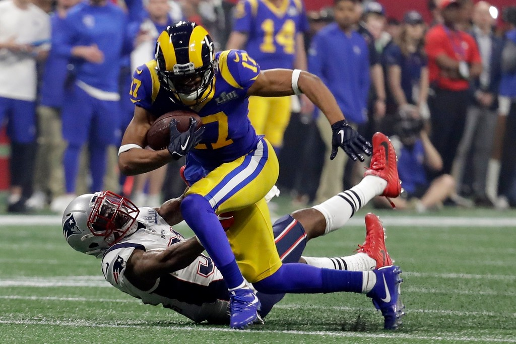 . Los Angeles Rams\' Robert Woods (17) breaks a tackle by New England Patriots\' Jonathan Jones (31) during the second half of the NFL Super Bowl 53 football game Sunday, Feb. 3, 2019, in Atlanta. (AP Photo/Lynne Sladky)