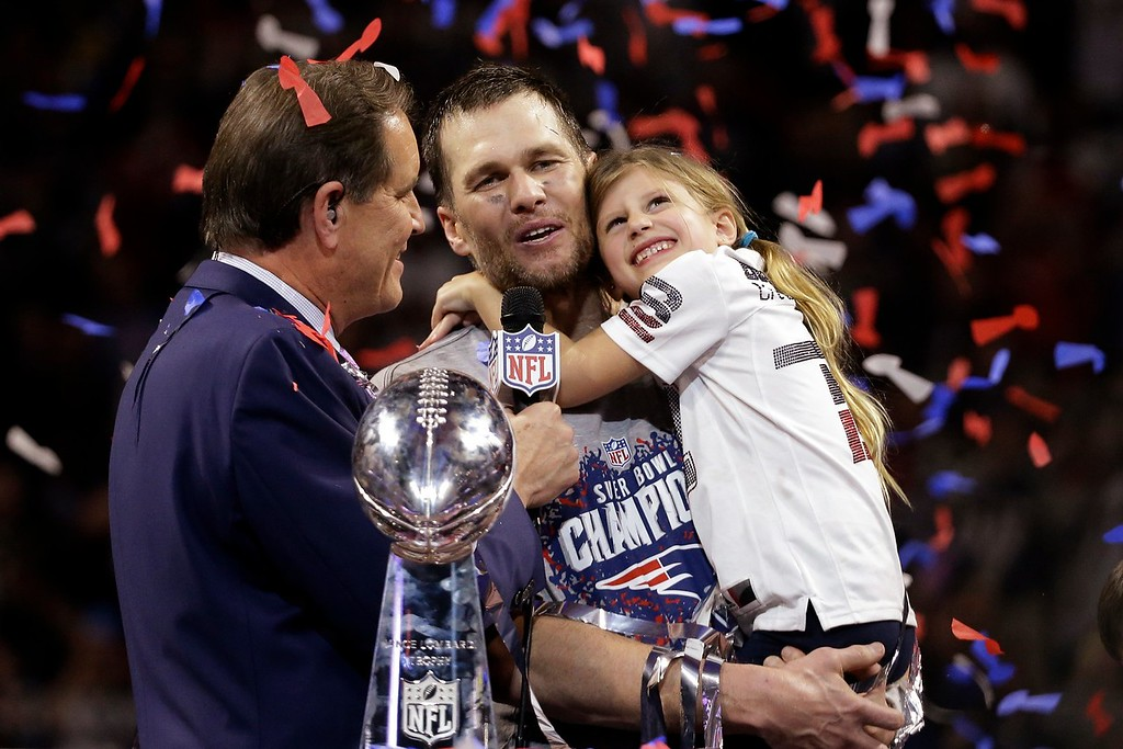 . New England Patriots\' Tom Brady holds his daughter, Vivian, after the NFL Super Bowl 53 football game against the Los Angeles Rams, Sunday, Feb. 3, 2019, in Atlanta. The Patriots won 13-3. (AP Photo/Mark Humphrey)