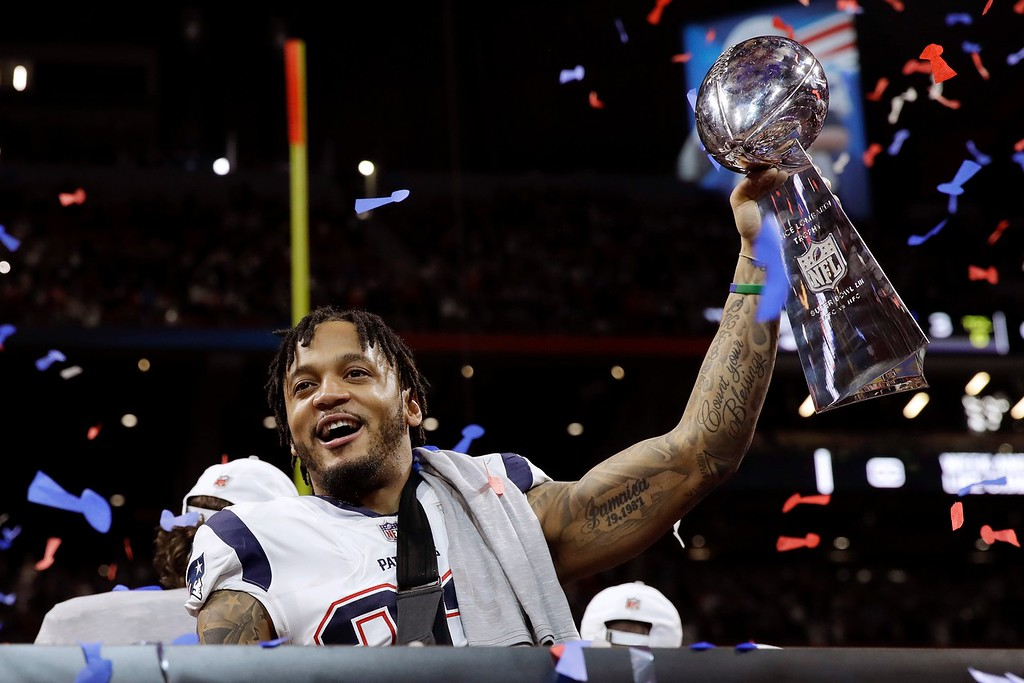 . New England Patriots\' Patrick Chung lifts the trophy after the NFL Super Bowl 53 football game against the Los Angeles Rams, Sunday, Feb. 3, 2019, in Atlanta. The Patriots won 13-3. (AP Photo/Carolyn Kaster)