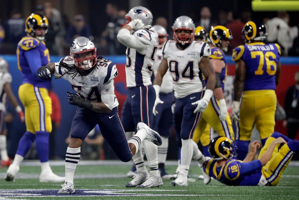 . New England Patriots\' Dont\'a Hightower (54) celebrates after he sacked Los Angeles Rams\' Jared Goff, down on the turf at right, during the second half of the NFL Super Bowl 53 football game Sunday, Feb. 3, 2019, in Atlanta. (AP Photo/Chuck Burton)