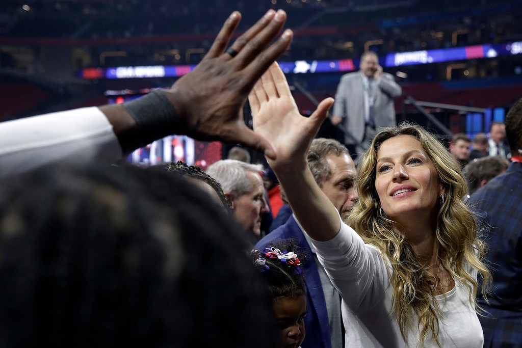 . Gisele Bundchen, wife of New England Patriots quarterback Tom Brady, gives a high-five after the NFL Super Bowl 53 football game against the Los Angeles Rams, Sunday, Feb. 3, 2019, in Atlanta. The Patriots won 13-3. (AP Photo/Patrick Semansky)