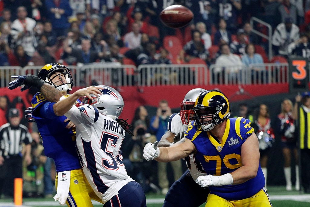 . New England Patriots\' Dont\'a Hightower (54) hits Los Angeles Rams\' Jared Goff, left, as he throws a pass during the second half of the NFL Super Bowl 53 football game Sunday, Feb. 3, 2019, in Atlanta. (AP Photo/David J. Phillip)