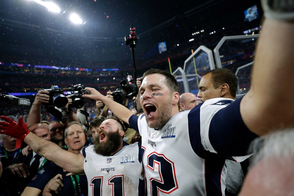 . New England Patriots\' Julian Edelman, left, and Tom Brady celebrate after the NFL Super Bowl 53 football game against the Los Angeles Rams, Sunday, Feb. 3, 2019, in Atlanta. The Patriots won 13-3. (AP Photo/David J. Phillip)