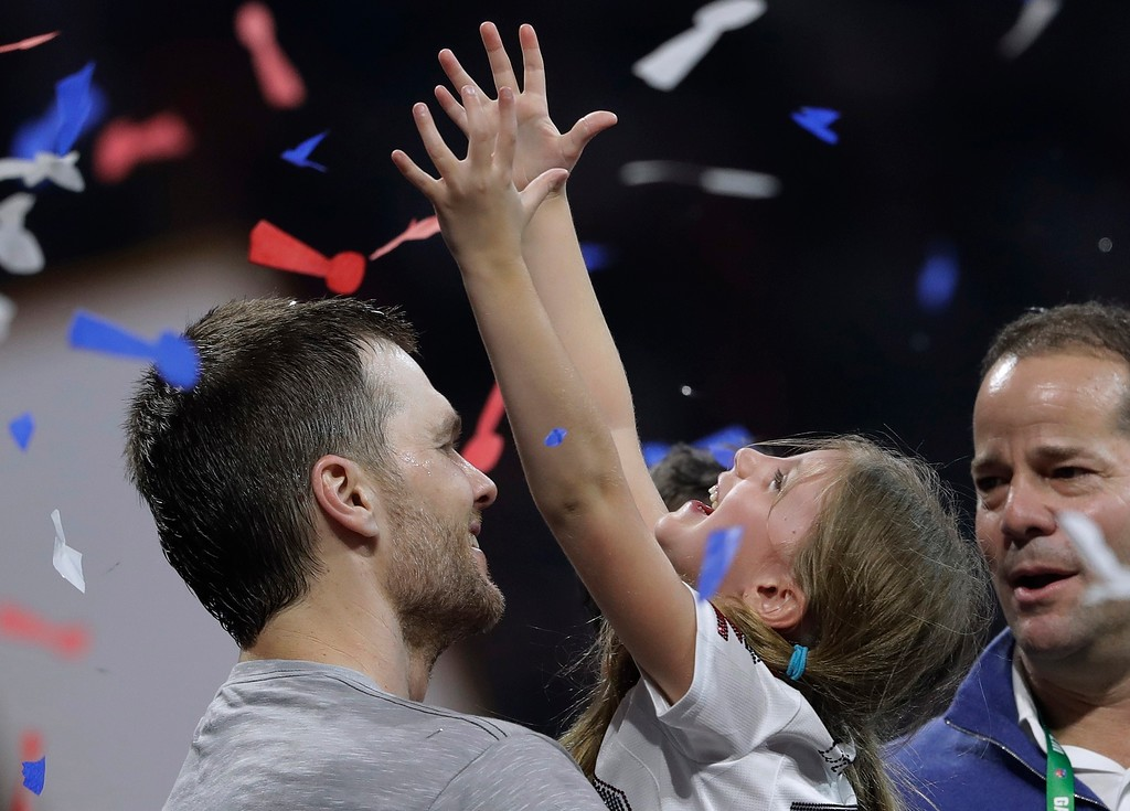 . New England Patriots\' Tom Brady holds his daughter, Vivian, after the NFL Super Bowl 53 football game against the Los Angeles Rams, Sunday, Feb. 3, 2019, in Atlanta. The Patriots won 13-3. (AP Photo/John Bazemore)