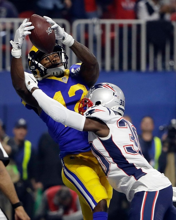 . New England Patriots\' Jason McCourty (30) breaks up a pass in the end zone intended for Los Angeles Rams\' Brandin Cooks (12) during the second half of the NFL Super Bowl 53 football game Sunday, Feb. 3, 2019, in Atlanta. (AP Photo/Matt Rourke)