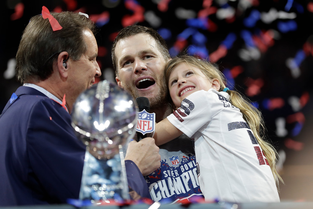 . New England Patriots\' Tom Brady holds his daughter Vivian, after the NFL Super Bowl 53 football game against the Los Angeles Rams, Sunday, Feb. 3, 2019, in Atlanta. The Patriots won 13-3. (AP Photo/David J. Phillip)