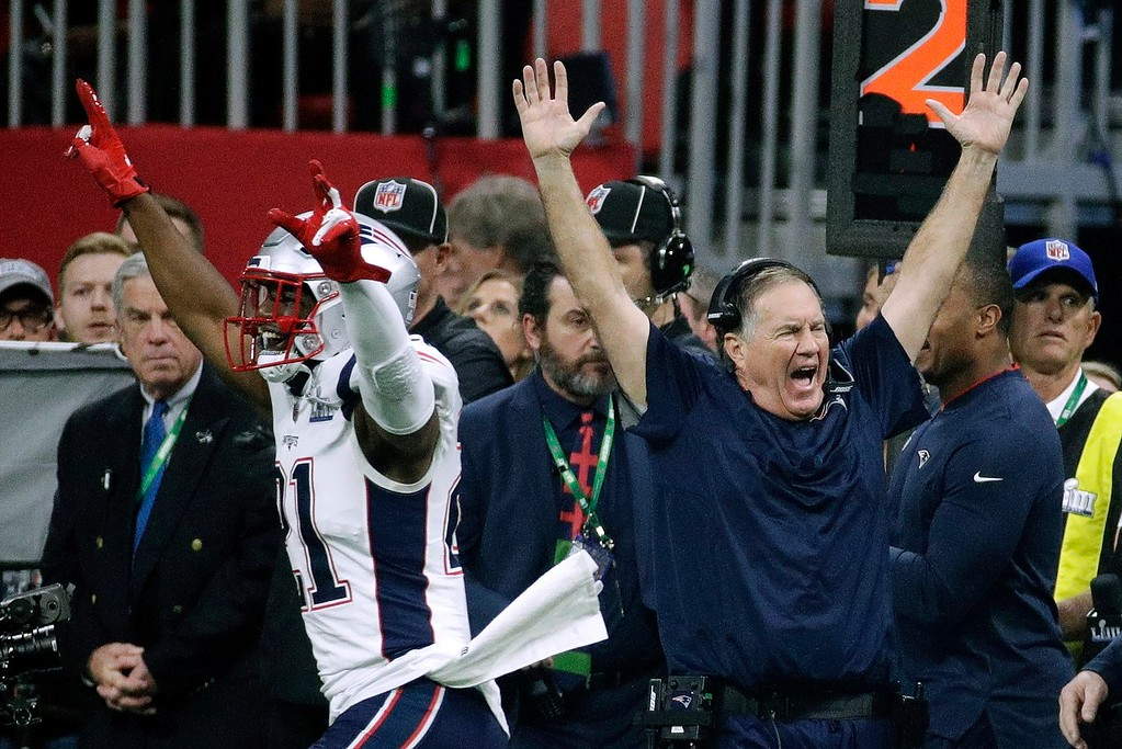 . New England Patriots\' Duron Harmon (21) and head coach Bill Belichick celebrate after the NFL Super Bowl 53 football game against the Los Angeles Rams Sunday, Feb. 3, 2019, in Atlanta. The Patriots won 13-2. (AP Photo/Patrick Semansky)