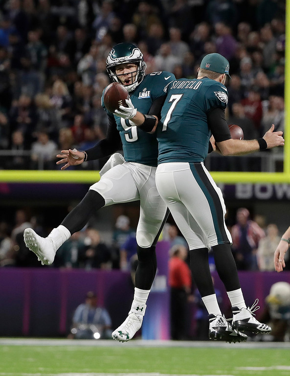 . Philadelphia Eagles quarterback Nick Foles celebrates his touchdown catch with Nate Sudfeld (7) during the first half of the NFL Super Bowl 52 football game against the New England Patriots Sunday, Feb. 4, 2018, in Minneapolis. (AP Photo/Matt Slocum)