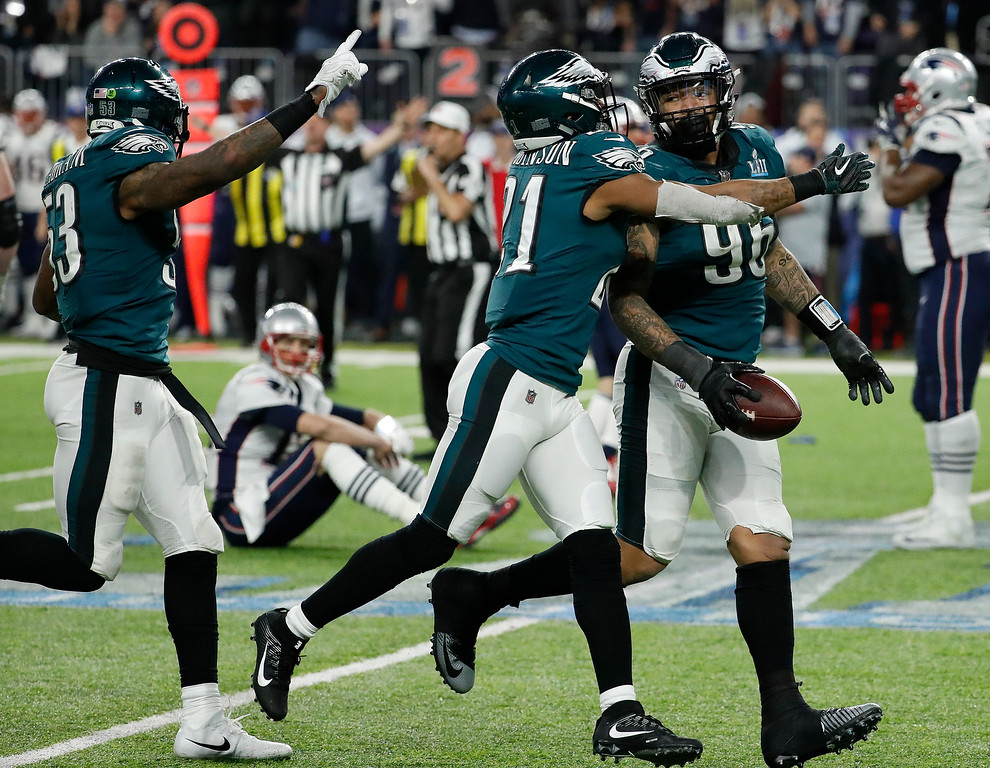. Philadelphia Eagles\' Derek Barnett (96) celebrates after recovering a fumble by New England Patriots\' Tom Brady, sitting, during the second half of the NFL Super Bowl 52 football game Sunday, Feb. 4, 2018, in Minneapolis. (AP Photo/Matt York)