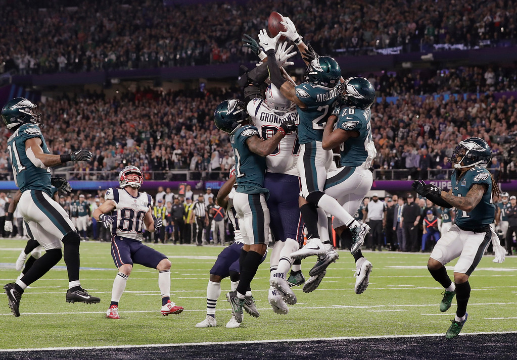 . New England Patriots tight end Rob Gronkowski (87) together with Philadelphia Eagles free safety Rodney McLeod (23) and cornerback Jaylen Watkins (26) jump for a pass in the end zone, during the second half of the NFL Super Bowl 52 football game, Sunday, Feb. 4, 2018, in Minneapolis. The Eagles won 41-33. (AP Photo/Tony Gutierrez)